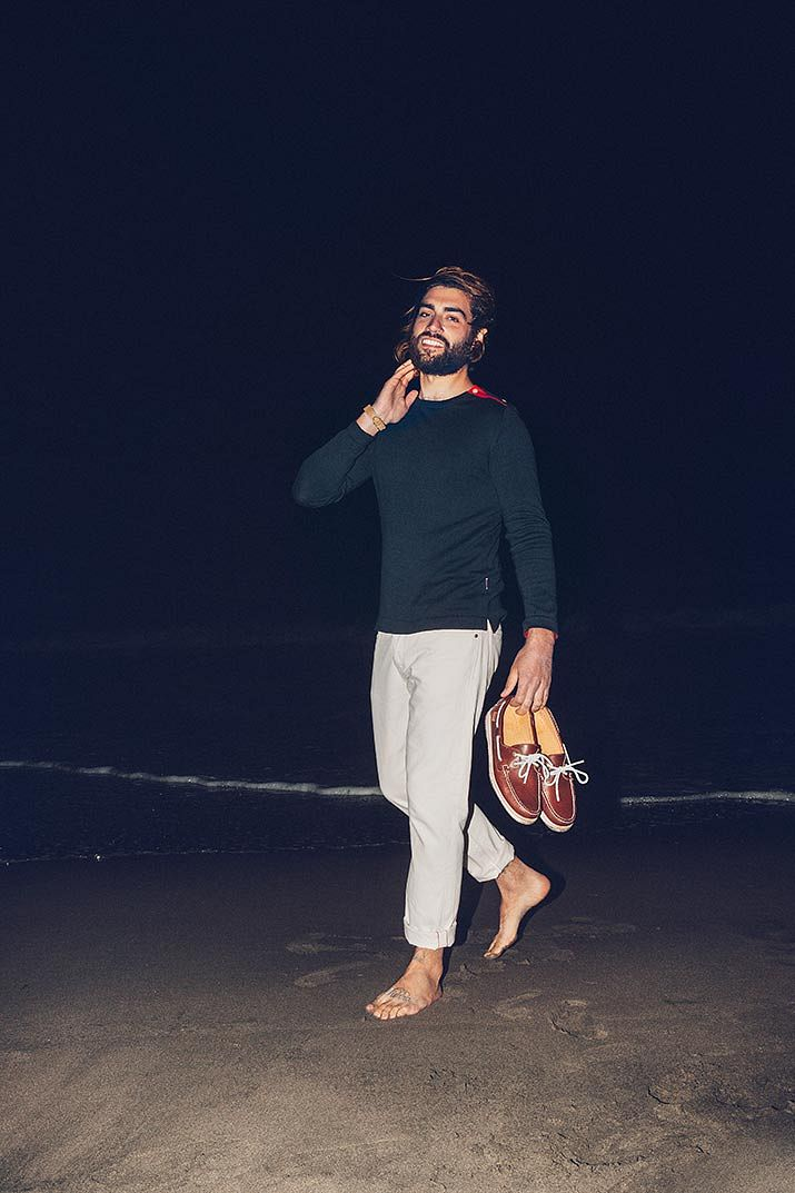 Sebago model on beach with boat shoes